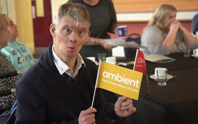 One of our Learning Disability service users waves an Ambient flag at the Grantham Get Connected event