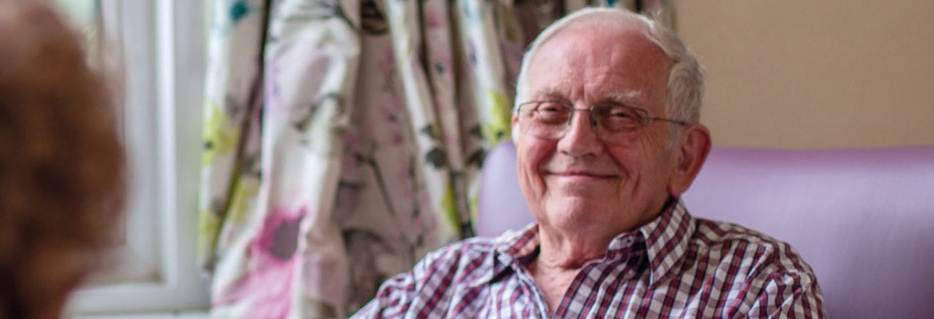 A service user at one of our Older People services smiles